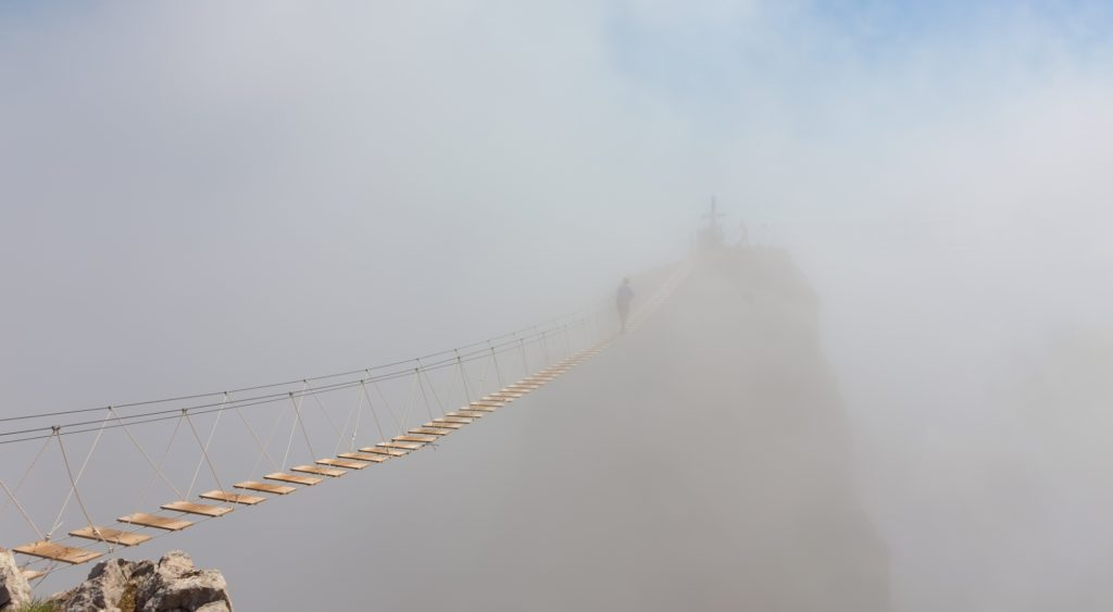what is the human cloud: wooden suspension bridge in the clouds