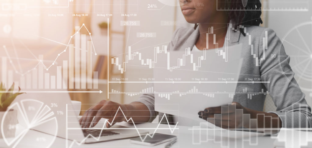 Corporate Finance Consulting Why On Demand Talent Are A Perfect Fit Blog Header - woman working on finance at a desk